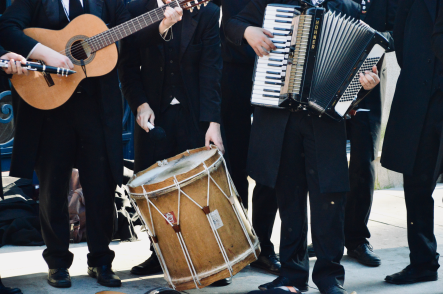 University of Porto, Portugal - Student club dressed in traditional learning capes (inspired Harry Potter uniforms) play traditional school songs. Instruments in photo are drum, accordion, and guitar.